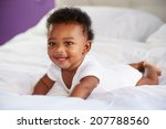 cute baby lying on tummy in... | Shutterstock . vector #207788560