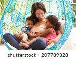 Mother With Children Relaxing...