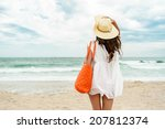 woman in straw hat and white... | Shutterstock . vector #207812374