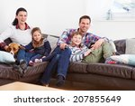 family relaxing indoors... | Shutterstock . vector #207855649