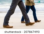 couple walking away on the beach | Shutterstock . vector #207867493