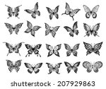 Stock vector set of twenty ornate black and white flying butterflies with open wings for use as design elements 207929863