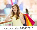 smiling girl with smartphone in