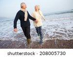 Senior Couple Walking Along...