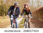 Couple On Cycle Ride In Winter...