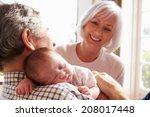 grandparents holding sleeping... | Shutterstock . vector #208017448