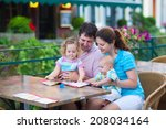 happy family of four  young... | Shutterstock . vector #208034164