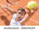 young man playing tennis | Shutterstock . vector #208134154