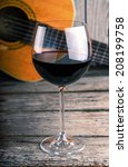 guitar and wine on a wooden... | Shutterstock . vector #208199758