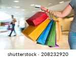 female holding shopping bags at ... | Shutterstock . vector #208232920