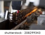 pharmaceutical production line | Shutterstock . vector #208299343