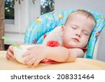 Baby Sleeping While Eating At...