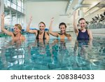 female fitness class doing aqua ... | Shutterstock . vector #208384033