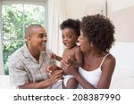 happy couple on bed with baby... | Shutterstock . vector #208387990