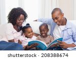 happy family on the couch... | Shutterstock . vector #208388674