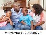 family relaxing together on the ... | Shutterstock . vector #208388776
