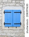 Closed Blue Window Blinds At...