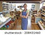 Owner Of Delicatessen Standing...