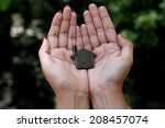 woman hands holding house  | Shutterstock . vector #208457074