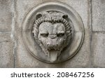 old relief with lion head | Shutterstock . vector #208467256