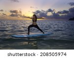 woman doing yoga on a stand up... | Shutterstock . vector #208505974