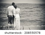 bride and groom on the beach  a ... | Shutterstock . vector #208550578