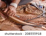 craftsman carving wood. | Shutterstock . vector #208555918