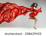 woman in red waving dress with... | Shutterstock . vector #208629433