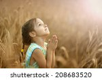 Cute Happy Little Girl Prays I...