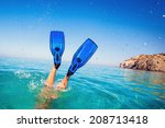 Flippers In Water. Diver Fins....