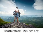 couple of hikers taking photo... | Shutterstock . vector #208724479