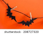 Two Black Bats On A Black Line...