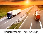 two trucks in motion blur on...   Shutterstock . vector #208728334