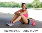 Woman Sit With Pink Kettlebell  ...