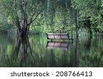 park bench in reflection  | Shutterstock . vector #208766413