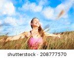 woman enjoying beautiful summer ... | Shutterstock . vector #208777570