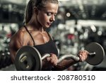 young woman bodybuilder with... | Shutterstock . vector #208780510