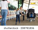happy family reunion at airport | Shutterstock . vector #208781836