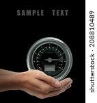 speedometer. man hand holding... | Shutterstock . vector #208810489