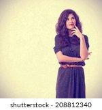 pensive girl posing | Shutterstock . vector #208812340