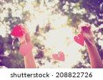 Hands Holding Paper Heart ....