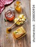 fresh honey and sliced lemon on ... | Shutterstock . vector #208830934
