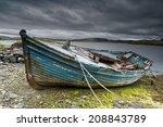 Weathered Fishing Boat Lying On ...