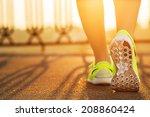 runner woman feet running on... | Shutterstock . vector #208860424