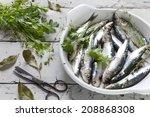 fresh raw sardines on dish with ... | Shutterstock . vector #208868308