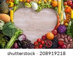 Stock photo heart shaped food food photography of heart made from different fruits and vegetables on wooden 208919218