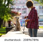 Woman Walking With A Pet In Th...