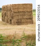 Stacked Bales Of Hay On A Field ...