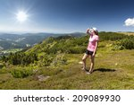 girl looks out over the... | Shutterstock . vector #209089930