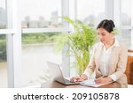 young vietnamese manager using... | Shutterstock . vector #209105878